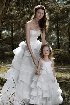 We love flower girls dresses as mini-brides!  #papiliokids #flowergirl #whitedress #kidsfashion #weddingfashion #wedding #girlsfashion #girl #dress #minibride #matching