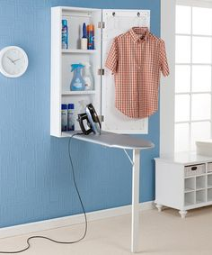 Ironing is no longer a chore with this wall-mounted ironing center. This ironing board and storage center keeps everything conveniently located in one space-saving area. You will have plenty of space Deco Cool, Storage Center, Storage Units, Iron Storage, Storage Mirror, Laundry Room Organization, Organization Ideas, Laundry Rooms, Storage Ideas