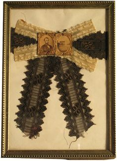 Arm band belonging to Mary Wilson Jasper. She and her husband, Samuel Branch Jasper, were staunch supporters of President Lincoln. Mary was heart-broken at Lincoln's death and traveled to Springfield, Ill for his funeral. She wore the armband at his funeral and throughout an extended period of mourning, hence the white bow she added later.