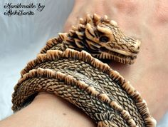 Just a little ivory dragon that wants to be tamed and live around your wrist. :)  This dragon bangle bracelet The Guardian is made of polymer