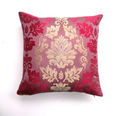 Champagne Damask Pillow  by The Divine Chair    Though known for its wild, reupholstered vintage furniture, The Divine Chair makes beautiful, decorative pillows. Relax in stylish comfort on this square pillow covered with damask print of champagne and muted red. This double-sided pillow features an invisible zipper and removable insert.