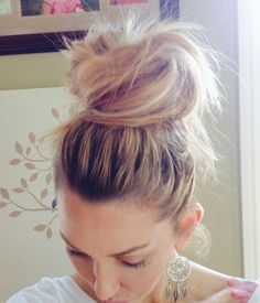 Step 1: Put your hair up in a high ponytail, and secure it tightly using an elastic hair band. Make sure the back side of your hair is smo...