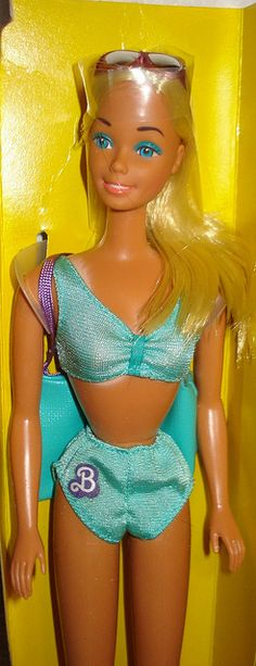 Sun Lovin Malibu Barbie by Barbie. I personally blame Mattel for my tanning addiction ;-) The tan lines were so funny; still have the doll but not the bathing suit.