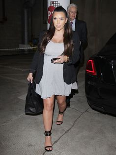 Kim Kardashian Covers Baby Bump In Casual Striped Minidress: Hot Or Not?
