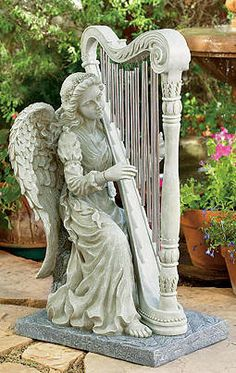 small angel statues for graves - Google Search