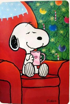 Snoopy on the red chair enjoy a mug of Hot chocolate by the Christmas tree.  Ahhh....