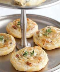 Caramelized Shallot and Blue Cheese Honeyed Swirls: This delicate pastry balances salty and sweet flavors with the use of shallots and honey, and is perfectly suited to an afternoon tea.