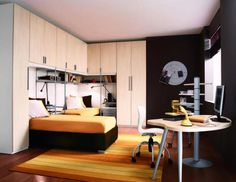http://trainingjo.com/wp-content/uploads/2014/11/Exotic-boy-room-with-white-study-desk-and-white-closet-cupboard-along-with-orange-striped-rug-on-wooden-laminate-flroor-as-well-orange-bedding-also-black-paint-wall.jpg