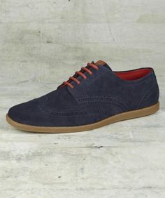 Rich suede shoes featuring traditional brogue detailing modernised with contrast coloured rubber soles. Complete with tartan lining and round cotton laces, these soft suede brogues are both classic and contemporary. Finished with subtle embossed branding