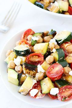 GRILLED ZUCCHINI, CHICKPEA, TOMATO, AND GOAT CHEESE SALAD. 20 Ketogenic Recipes to Make on the Grill This Summer #purewow #food #grilling #cooking #recipe #chickpeas #salad #chickpeasalad #grilledrecipes #vegetarianrecipes