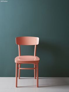PLAY WITH DIFFERENT GLOSS LEVELS-- Why not accentuate the details on chairs with differences in paint finishes? In this picture it has become a playful contrast between the coral-colored chair in color Butterfly (glossier) and the mat, blue-green wall.