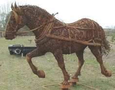 Rusty Draft Horse sculpture - photo by PNW Gail, via Flickr; scrap metal horse by Dixie Jewett