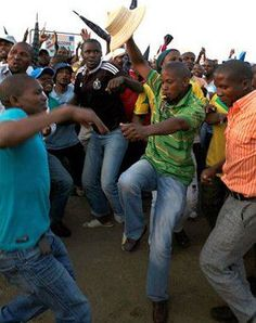VICTORY DANCE: Lonmin miners celebrate the pay hike that brought to an end the violent strike that has claimed the lives of 45 people since August 10. (AP)