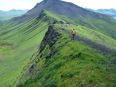 15 Amazing Jobs at the Interior Department   U.S. Department of the Interior ~ Michelle Coombs walks along a ridge towards Cascade Bight vent in Alaska. Photo by U.S. Geological Survey. Location: Alaska Volcano Observatory in Anchorage, Alaska
