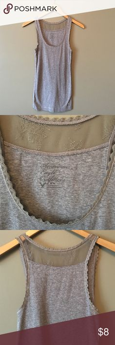 American Eagle gray tank with lace American Eagle gray tank with lace on collar, arms and back lace panel. American Eagle Outfitters Tops Tank Tops