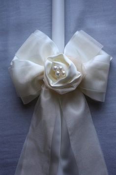 Ivory Satin Lambatha with Satin Rose Center, $186.10 at the Greek Wedding Shop ~ http://www.greekweddingshop.com/
