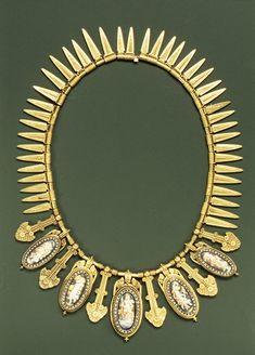 ca. 1870, Necklace. Eugène Fontenay.  Gold, enamel, diamonds  This gold chain has five oval enameled pendants depicting personifications of Europe and the Seasons. Each oval is framed in diamonds interspersed with long stylized palmette-shaped pendants, and forty-one leaf-shaped pendants, decorated with granulation and wirework suspended from alternately plain and coiled tubular links.