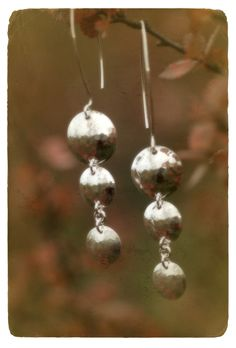 Hammered silver earrings made by Tytti Bräysy