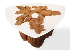 The Bloom table crafted by MTH Woodworks: a mix between sleek resin and tree stump.