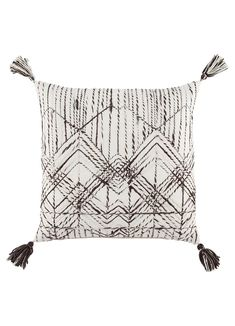 The Omni collection designed by Nikki Chu features an assortment of globally inspired patterns, versatile colorways, and boho-femme vibes. The gray and white Nyx pillow showcases a textured geometric lattice made of twisted yarns for a dose of dimensional charm. Tasseled corners accent this cotton and viscose cushion to complement the worldly vibes.