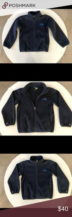 North Face Boys Fleece Full Zip Jacket. Navy Blue Boys Fleece Full zip jacket . Does have snaps on sleeves to use as a fleece lining insert for the North Face rain jackets . North Face Jackets & Coats
