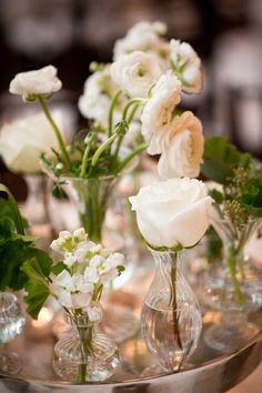Lovely collections of white flowers in bud vases / www.keelythorne.com / Chris Bailey Photography