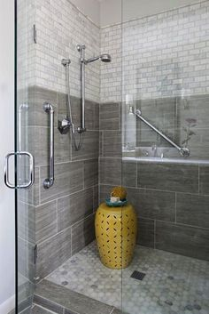 bathroom shower with seamless doors.  large grey tile