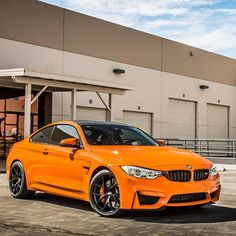 2016 BMW M4 .... in orange. Looks like one of these could be the replacement for my RS5 Coupe this summer