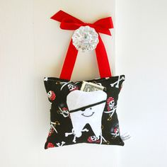 Boy's Tooth Fairy Pillow in Pirate Print. $18.00, via Etsy.