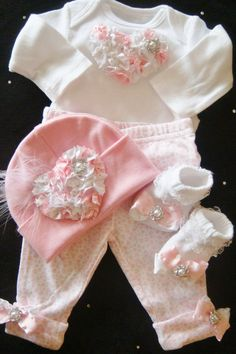 NEWBORN baby girl take home outfit complete with oversized pink heart onesie, matching pants, hat and socks. $45.00, via Etsy.