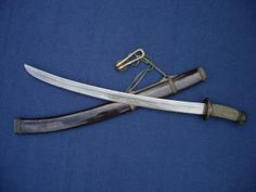 An antique Chinese duandao or short saber with horse-tooth patterned blade.