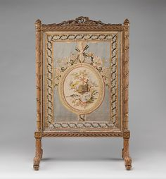 Fire screen (écran)  Maker: Georges Jacob (French, 1739–1814) Maker: Fabric panel in the style of Philippe de Lasalle (French, 1723–1804) Date: ca. 1786 Culture: French, Paris Medium: Carved, gilded and silvered beech; 18th-century silk brocade (not original to frame) Accession Number: 1971.206.16