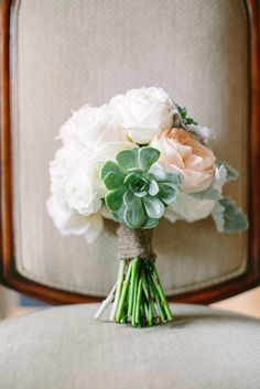 love this delicate wedding bouquet http://www.weddingchicks.com/2013/09/11/peach-and-gray-wedding/