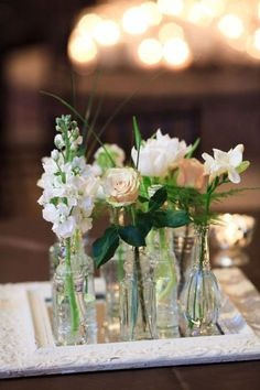 These sweet blooms in assorted vintage vases make for a unique and affordable centerpiece.
