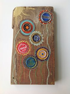 Flower Bottle Cap Painting on Barn Wood available on Etsy