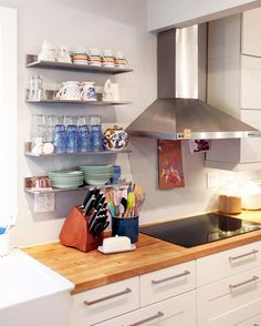 Open shelves and stainless steel hood