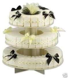 I love this idea, wedding cake boxes that make up a wedding cake, the guests can help themselves to cake!