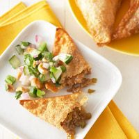 Asian BBQ Pork Wontons with Cucumber-Peanut Salsa - In this recipe, hoisin, a traditional Chinese sweet and spicy sauce, blends with pork, honey, fresh ginger and cilantro for Asian-inspired flavor. Fresh jalapeno chile pepper adds extra zing to this easy party appetizer.