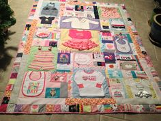 quilt made out of first year baby clothes