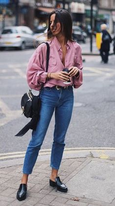 Pretty pink blouse with blue jeans.