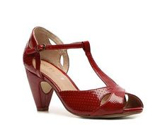 """The Nico from Chelsea Crew is style to a tee. This T-strap pump is flirty and fun with details that won't disappoint!        Faux patent leather, perforated upper      T-strap with adjustable ankle strap      3"""" covered heel      Synthetic sole      Imported"""
