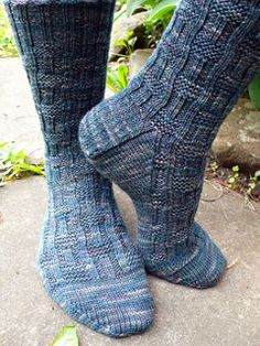 Roger socks. Here's a top-down unisex sock in three sizes S(M, L) with an appealing rib-and-garter texture traveling down the leg and over the top of the foot. The easily memorized motif makes for a good traveling project that is uncomplicated by cables or tricky sts; pattern may be reversed for toe-up construction.