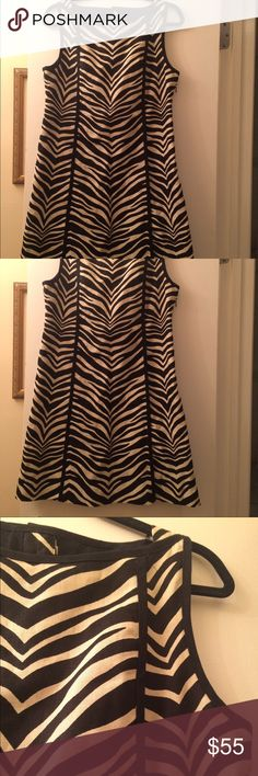 J Crew 100% Linen Zebra Dress Fantastic dress in excellent condition. 100% linen but thick, so it does not wrinkle easily the way thin linen material does. Back of dress has great knotted button. Dress is very structured and well made. J. Crew Dresses