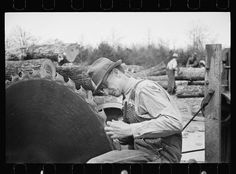 Sharp[ening a saw blade,  Wilson Cedar Forest, near Lebanon, Tennessee, Carl Mydans photographer, March 1936, Farm Security Administration/Office of War Information Black-and-White Negatives, Library of Congress Prints and Photographs Division Washington 1930s America, Lebanon Tennessee, Cedar Forest, Dust Bowl, Great Depression, Library Of Congress, Division, Vintage Photos, Abandoned