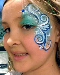 Chicago Face Painting by Valery - Blue Eye Design with Swirls - Chicago-Face Painter-Valery-Lanotte #facepaintingideasforadults