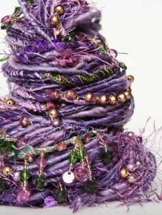 I love crazy yarn. It'd make lovely art doll hair or woven wall pieces or something.