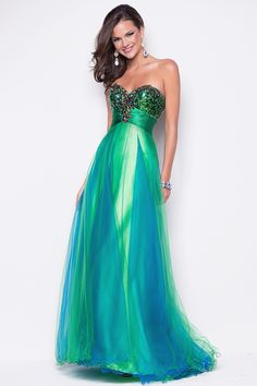 Sexy prom dress in chiffon! This beaded bustier with sheer satin waist flows into a full chiffon skirt.