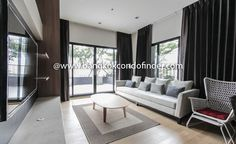 2 Bedroom Condo for Rent at Noble Reveal  To find out more of this building & available apartments or condos for rent, go to:   http://bangkokcondofinder.com/?pagename=search-results&price=75000 This 2 bedroom condo for rent at Noble Reveal is modern and fully furnished with 117 square meters spread. The main area in this high rise condo is outfitted in neutral and grey colors, light wood floors, and floor to ceiling with blackout drapes. The living room is set with a