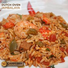 Dutch Oven jambalaya - olive oil - smoked sausage - green bell pepper - celery - Cajun seasoning - white rice - 14.5 oz. can diced tomatoes - minced garlic - chicken broth - bay leaves - dried thyme - medium shrimp