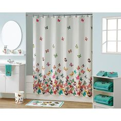 Butterfly bathroom decor from KMart.  Curtain is $15
